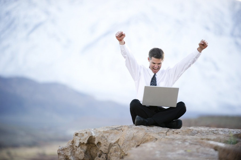 iStock_12573288LG-happy-man-laptop-rock